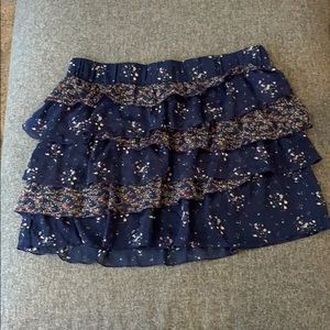 Size medium navy skirt with floral accents
